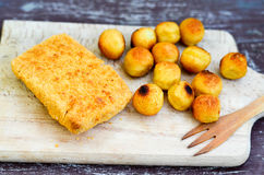 Fish and Croquette. On a wooden  plate Royalty Free Stock Image
