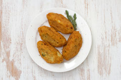 Fish croquettes on plate Stock Photos