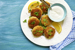 Fish croquettes. Fish croquettes on a white plate on blue wooden background.Top view stock photos