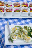 Fish cups & egg with herring Stock Photography