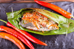 Fish curry in babana leaves. Royalty Free Stock Images
