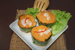 Fish curry in banana leaves, called Hor Mok in Thai Stock Photos