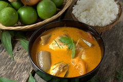 Fish curry in black bowl with rice Royalty Free Stock Photography