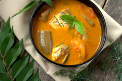 Fish curry in black bowl Stock Photos