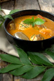 Fish curry in black bowl Stock Photo