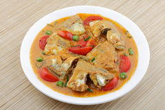 Fish curry with coconut. Hot and sour fish curry with coconut,coconut milk and vegetables Stock Images