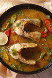 Fish curry with vegetables close-up on a plate. vertical top vie Royalty Free Stock Photo