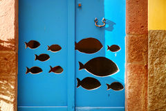 Fish cut out of blue door in Italy Royalty Free Stock Images