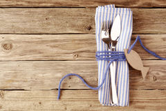 Fish Cutlery Tied on Purple Table Napkin with Tag Royalty Free Stock Images