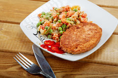 Fish cutlet with a vegetable garnish Stock Image