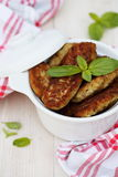 Fish cutlets countrylike in ceramic saucepan Stock Photos