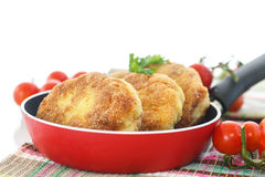 Fish cutlets. Fried fish cutlets in the corn flour on a white background Stock Photography
