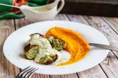 Fish cutlets with pumpkin puree and sauce stock image