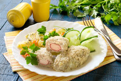 Fish cutlets stuffed with surimi and stewed potatoes with carrot Stock Image