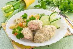 Fish cutlets stuffed with surimi and stewed potatoes with carrot Royalty Free Stock Photo