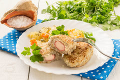 Fish cutlets stuffed with surimi and stewed potatoes with carrot Royalty Free Stock Images