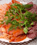 Fish cutting with sausage Stock Photo