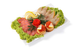 Fish delicacies, assorted smoked salted salmon and sturgeonon wh Royalty Free Stock Photos