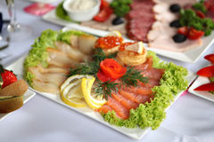 Fish delicacies on laid table Royalty Free Stock Photography