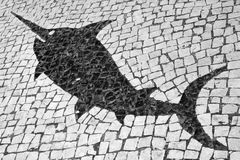 Fish Design in Portuguese Mosaic Street Tiles Stock Photo