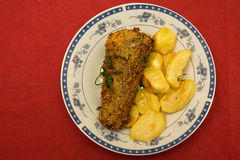 Fish dinner. Roasted fish and potatoes  for dinner Stock Photos