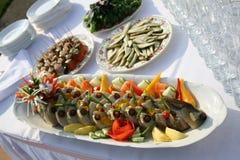 Fish on the Dish. Fourshette table Stock Photo