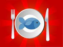 Fish dish. Fish in dish with knife and fork on sunburst background Stock Photo