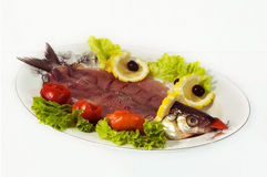Fish dish. Dish Baikal omul on the table allocated on a light background Stock Photography