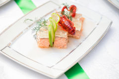 Fish dish and crayfish on the festive table Royalty Free Stock Photography