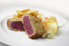 Fish dish escalope bluefin tuna breading capers and potatoes. Fish dish portion escalope bluefin tuna breading capers and potatoes Royalty Free Stock Image
