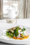 Fish dish - fillet of zander in plate on the table near window Stock Photo