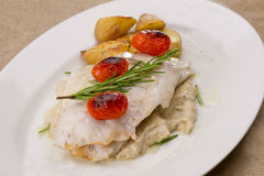 Fish dish - fish fillet in sauce and vegetables Stock Photo