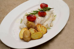 Fish dish - fish fillet in sauce and vegetables Royalty Free Stock Image