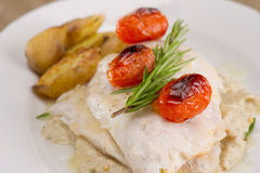 Fish dish - fish fillet in sauce and vegetables Stock Images