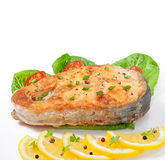 Fish dish - fried fish fillet with vegetables Stock Image