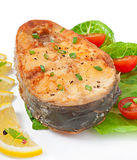 Fish dish - fried fish fillet with vegetables Royalty Free Stock Photography