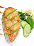 Fish dish - fried fish fillet with vegetables Stock Images
