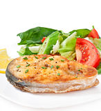 Fish dish - fried fish fillet with vegetables Royalty Free Stock Image