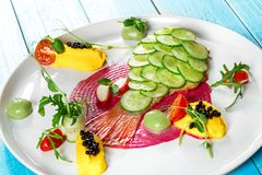 Fish dish - fried fish fillet and vegetables Royalty Free Stock Image