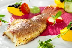 Fish dish - fried fish fillet and vegetables Stock Photography