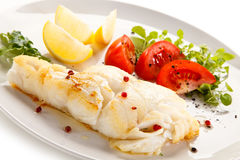 Fish dish - fried fish fillet and vegetables Stock Image
