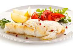 Fish dish - fried fish fillet and vegetables Stock Photo