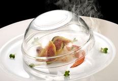 Fish dish, lobster and figs smoking. Gourmet fish dish, fish dish, lobster and figs smoking Stock Image