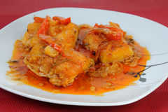 Fish dish with onions and peppers sauce Stock Photography