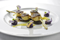 Fish Dish Skewer of Scallops Crusted with black Rice and Purple. Potatoes in white plate Stock Photo