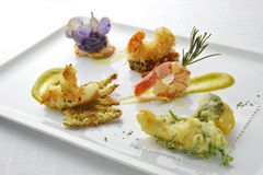 Fish Dish Tasting Prawns Fried  Grilled Braised Tempura Kataifi. In square white plate Royalty Free Stock Images