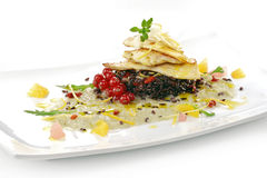 Fish dish, turbot fillet with citrus, fennel cream, black rice,. Gourmet fish dish, turbot fillet with citrus, fennel cream, black rice, currants and goji Royalty Free Stock Image