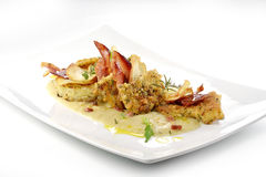 Fish dish, turbot fillets flavored crust, cips, rosti, creamed p. Gourmet fish dish, turbot fillets flavored crust, cips, rosti, creamed potatoes, crispy bacon Stock Photo