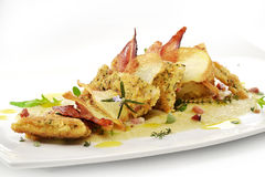 Fish dish, turbot fillets flavored crust, cips, rosti, creamed p. Gourmet fish dish, turbot fillets flavored crust, cips, rosti, creamed potatoes, crispy bacon Royalty Free Stock Photos