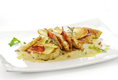 Fish dish, turbot fillets flavored crust, cips, rosti, creamed p. Gourmet fish dish, turbot fillets flavored crust, cips, rosti, creamed potatoes, crispy bacon Royalty Free Stock Images